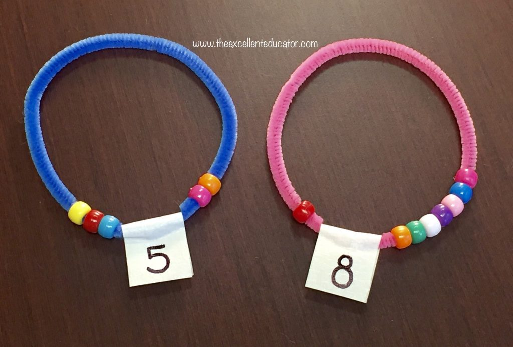 Place A Specific Number Of Beads On The Pipe Cleaner And Connect Ends By Twisting Them To Make Bracelet In Shape Circle